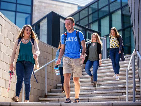 Students descend the steps at the Gatton Student Center